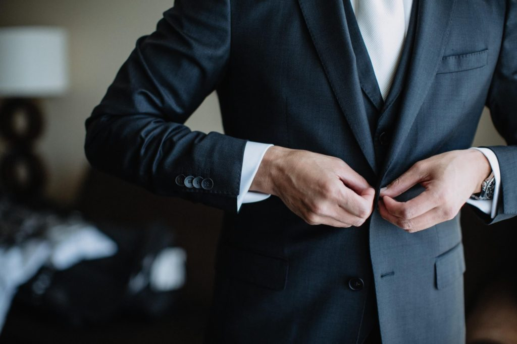 diverse-young-man-getting-ready-and-putting-on-his-suit-and-tie-formal-evening-wear-business-attire_t20_koe3aE.jpg