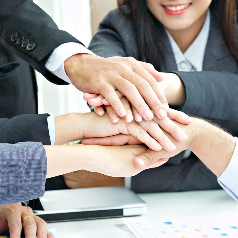 hand-of-teamwork-business-meeting-with-positive-result_t20_roYWVd.jpg